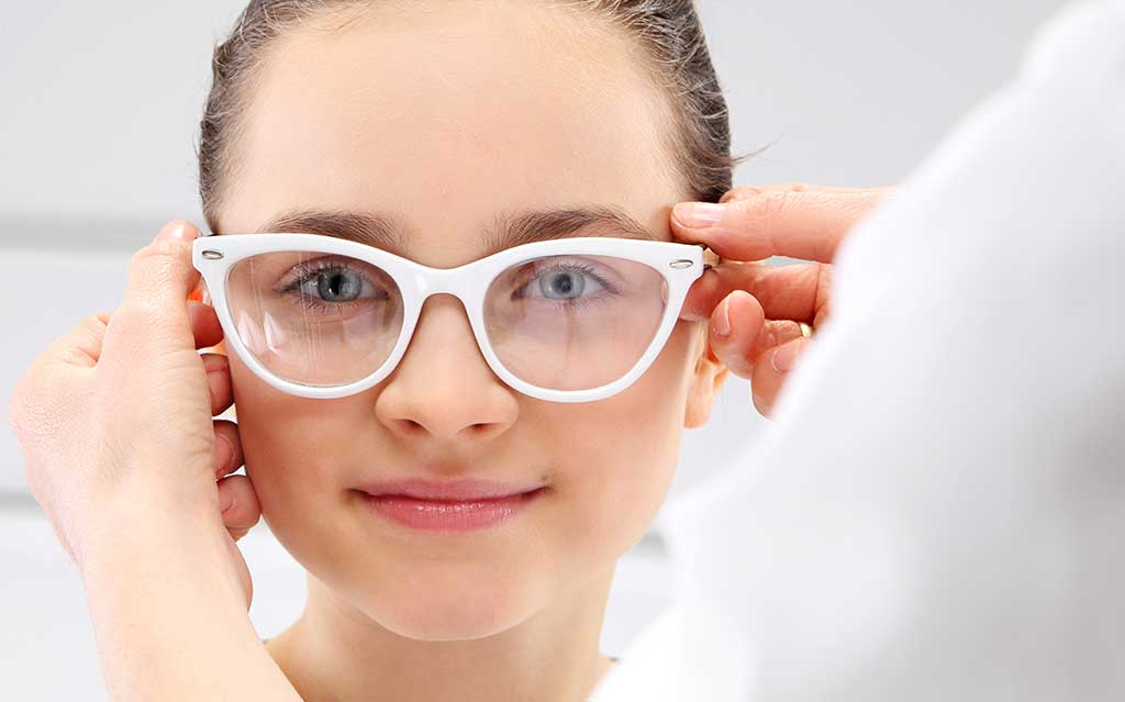 Girl with new pair of glasses on